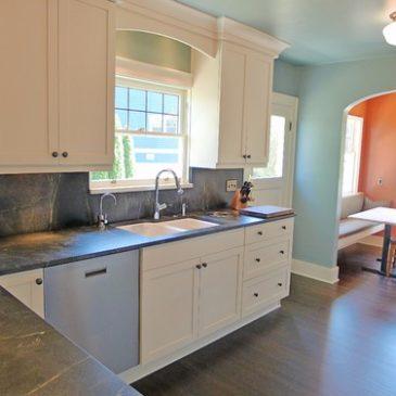 Soapstone Kitchen countertops with Full height soapstone backsplash